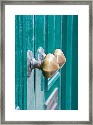 Door Handles Framed Print by Tom Gowanlock