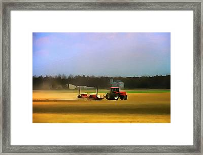 Red Tractor On The Farm Framed Print by Dan Sproul