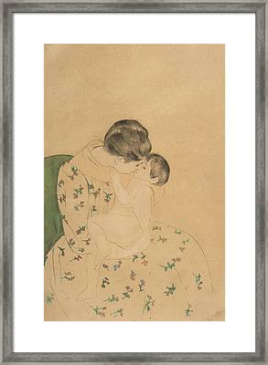 Mother's Kiss Framed Print by Mary Cassatt