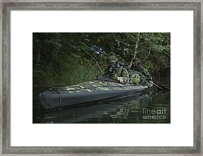 Navy Seals Navigate The Waters Framed Print by Tom Weber