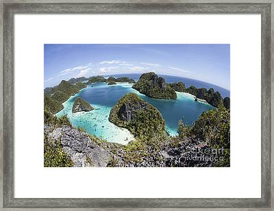 Rugged Limestone Islands Surround Framed Print