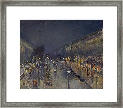 The Boulevard Montmartre At Night Framed Print by Camille Pissarro