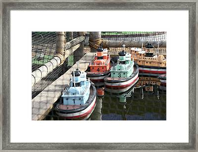 4 Toy Boats Framed Print