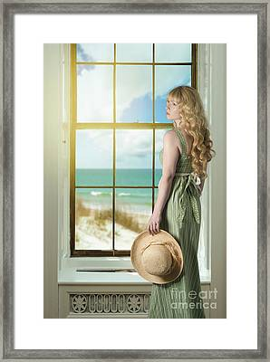 Woman At The Window Framed Print