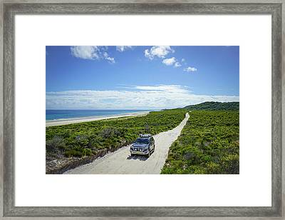 4wd Car Exploring Remote Track On Sand Island Framed Print