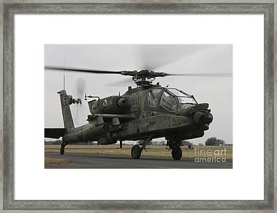 Ah-64 Apache Helicopter On The Runway Framed Print by Terry Moore