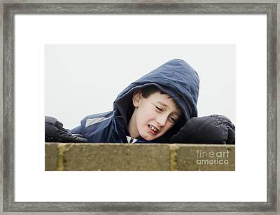 An Upset Child Framed Print by Tom Gowanlock