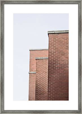 Brick Building Framed Print by Tom Gowanlock