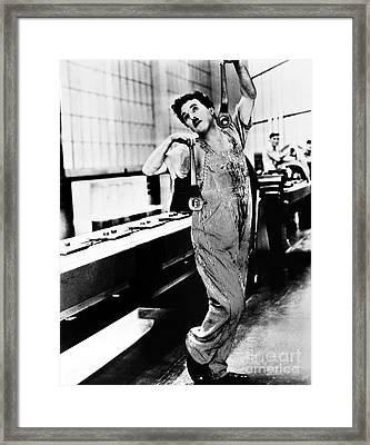 Chaplin: Modern Times, 1936 Framed Print by Granger