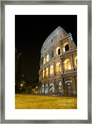 Coliseum Illuminated At Night. Rome Framed Print by Bernard Jaubert