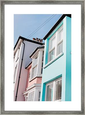 Colorful Houses Framed Print by Tom Gowanlock