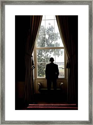 President Barack Obama Looks Framed Print