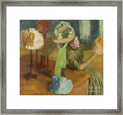 The Millinery Shop Framed Print