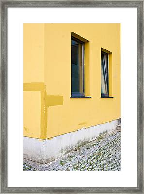 Yellow Building Framed Print by Tom Gowanlock