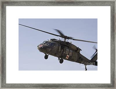 A Uh-60 Blackhawk Medivac Helicopter Framed Print by Terry Moore