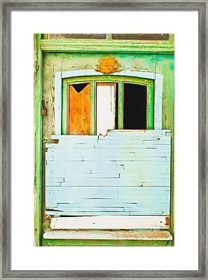 Boarded Up Window Framed Print by Tom Gowanlock