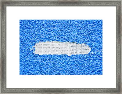 Damaged Wall Framed Print by Tom Gowanlock