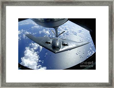 A B-2 Spirit Moves Into Position Framed Print by Stocktrek Images