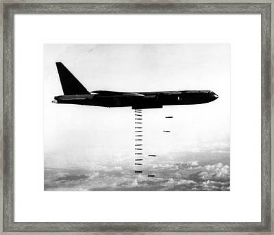 A B-52 Stratofortress Releases Bombs Framed Print by Everett