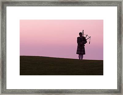 A Bagpiper On A Golf Course Framed Print by Richard Nowitz