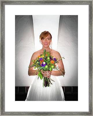 A Beautiful Backlit Bride And Her Bouquet Framed Print
