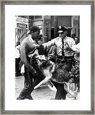 A Black Man Is Attacked By A Policeman Framed Print