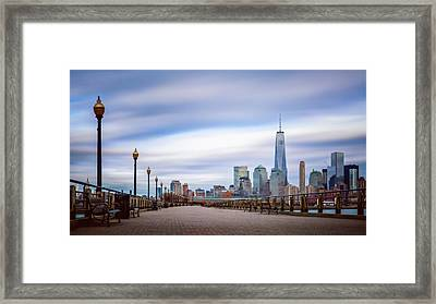 A Boardwalk In The City Framed Print