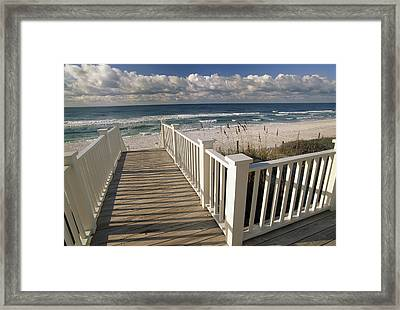 A Boardwalk Leads To An Empty Beach Framed Print