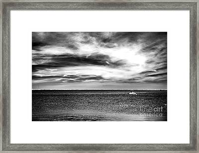 A Boat In The Bay Framed Print