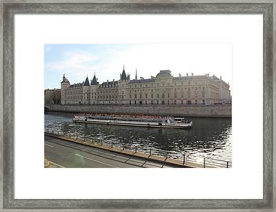 A Boat On The River Seine Framed Print by Rikki Prince
