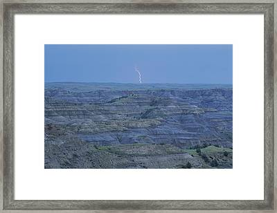 A Bolt Of Lightning Is Seen Framed Print