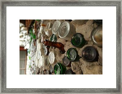 A Bottle In The Wall Framed Print