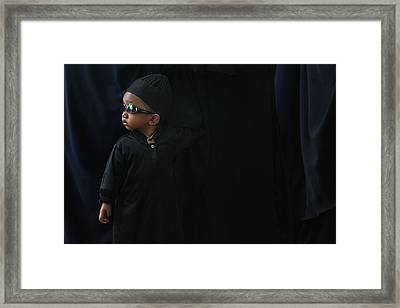 A Boy In The Rows Of Women Framed Print