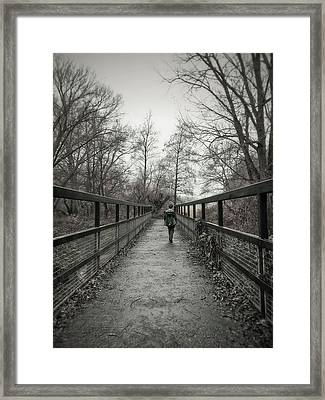 A Boy On A Bridge  Framed Print