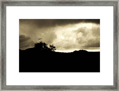 A Brewing Storm Framed Print