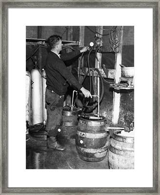 A Brewmeister Fills Kegs At A Bootleg Framed Print by Everett