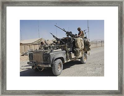 A British Armed Forces Land Rover Framed Print by Andrew Chittock