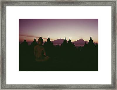 A Buddha Sits In The Framed Print by Dean Conger