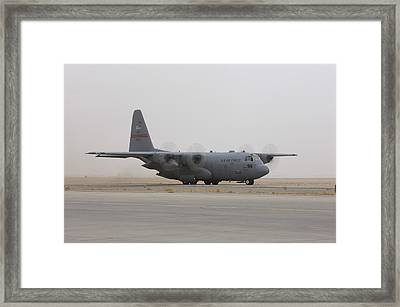 A C-130 Hercules Aircraft Taxis Framed Print