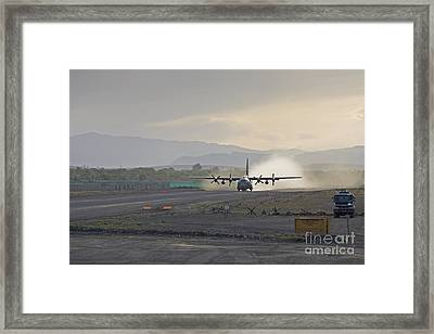 A C-130 Taking Off Framed Print by Tim Grams