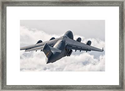 A C-17 Globemaster Flying Framed Print by Giovanni Colla