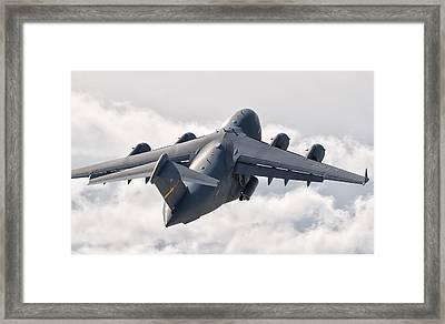 A C-17 Globemaster Flying Framed Print