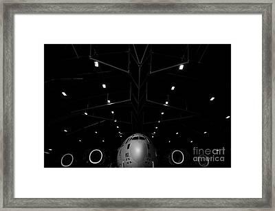 A C-17 Globemaster IIi Sits In A Hangar Framed Print