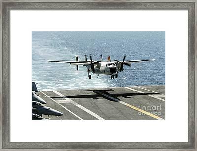 A C-2a Greyhound Prepares To Land Framed Print
