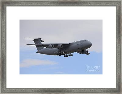 A C-5 Galaxy In Flight Over Nevada Framed Print by Remo Guidi