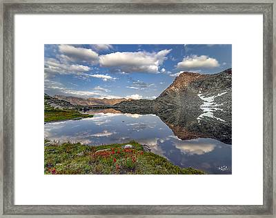 A Calm Mountain Lake Framed Print by Leland D Howard
