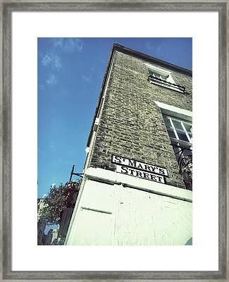 A Cambridge Building Framed Print by Tom Gowanlock