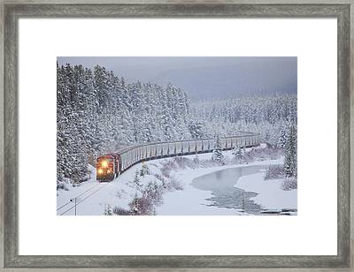 A Canadian Pacific Train Travels Along Framed Print