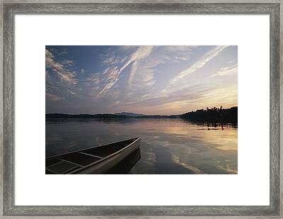 A Canoe On The Lower St. Regis Lake Framed Print by Michael Melford