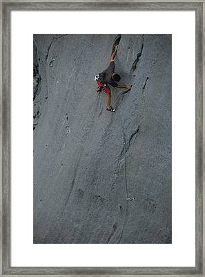 A Caucasian Man Rock Climbing Framed Print by Bobby Model